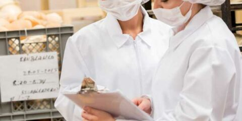two food inspectors in a bakery