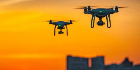 two drones flying over city